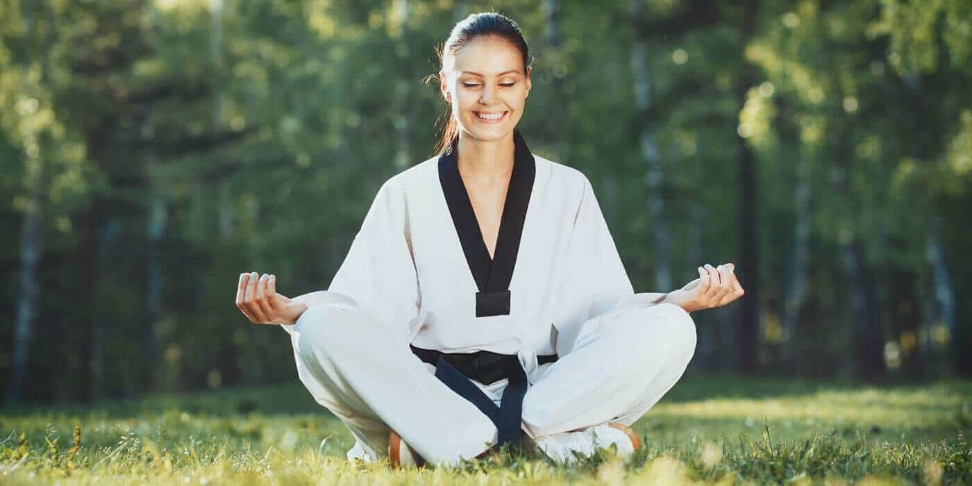 Martial Arts Lessons for Adults in __CITY__ __STATE__ - Happy Woman Meditated Sitting Background