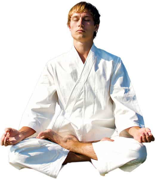 Martial Arts Lessons for Adults in __CITY__ __STATE__ - Young Man Thinking and Meditating in White