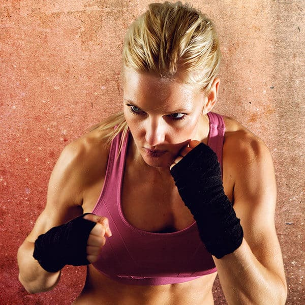 Mixed Martial Arts Lessons for Adults in __CITY__ __STATE__ - Lady Kickboxing Focused Background