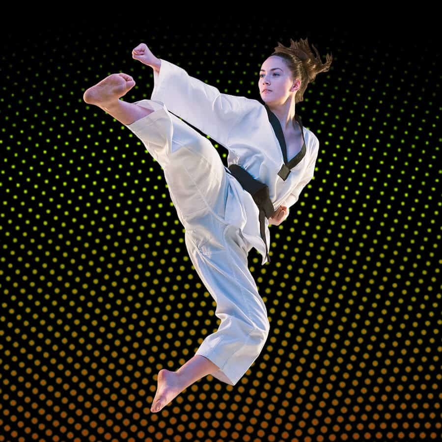 Martial Arts Lessons for Adults in __CITY__ __STATE__ - Girl Black Belt Jumping High Kick